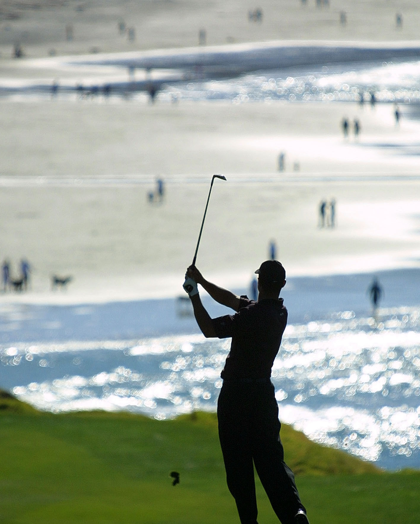 Tiger Woods hits his second shot on the ninth hole at Pebble Beach during the final round of the 2001 AT&T Pebble Beach National Pro-Am.