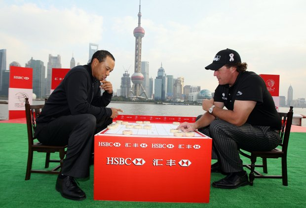 Tiger Woods and Phil Mickelson during a game of Chinese chess during the the Official 2009 WGC-HSBC Photocall at the Shanghai Port International Cruise Terminal on November 3, 2009.