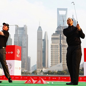 Tiger Woods and Phil Mickelson watch their shots near the Huangpu River during the the Official 2009 WGC-HSBC Photocall in Shanghai.