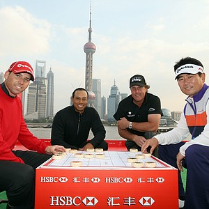 Sergio Garcia, Tiger Woods, Phil Mickelson and Y.E. Yang pose next to a Chinese chess game in Shanghai on November 3, 2009.