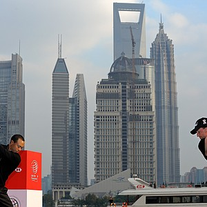 Tiger Woods and Phil Mickelson battling with tee shots in Shanghai.