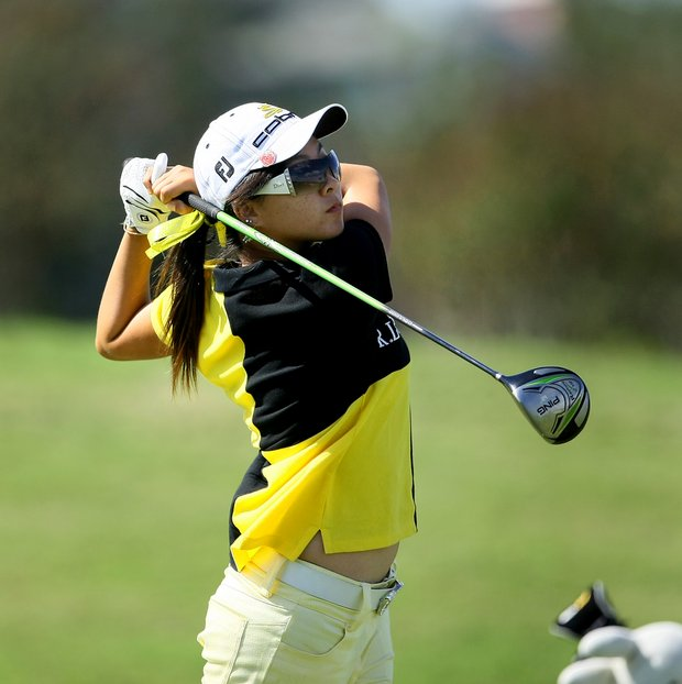 Linda Luo watches her tee shot on the Legacy Course.