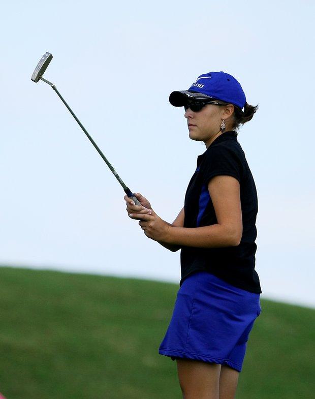 Alexandra Milan watches her putt at No. 18.