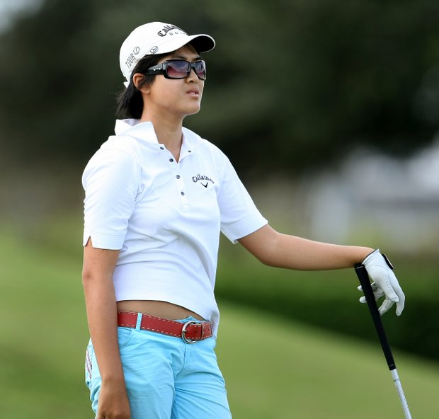 Yueer Cindy Feng  watches her tee shot at No. 17.