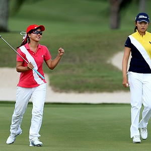 Linda Luo pumps her first after making par at No. 17. At right is Simin Feng.