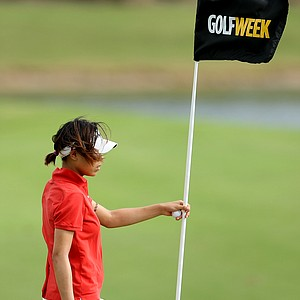 Marika Liu replaces the pin at No. 7 during the final round of the Golfweek Junior Invitational at Reunion Resort.