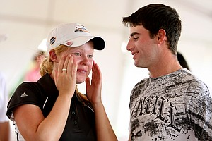 Stephanie Meadow talks with her boyfriend, Mike Balzer, after she won the Golfweek Junior Invitational.