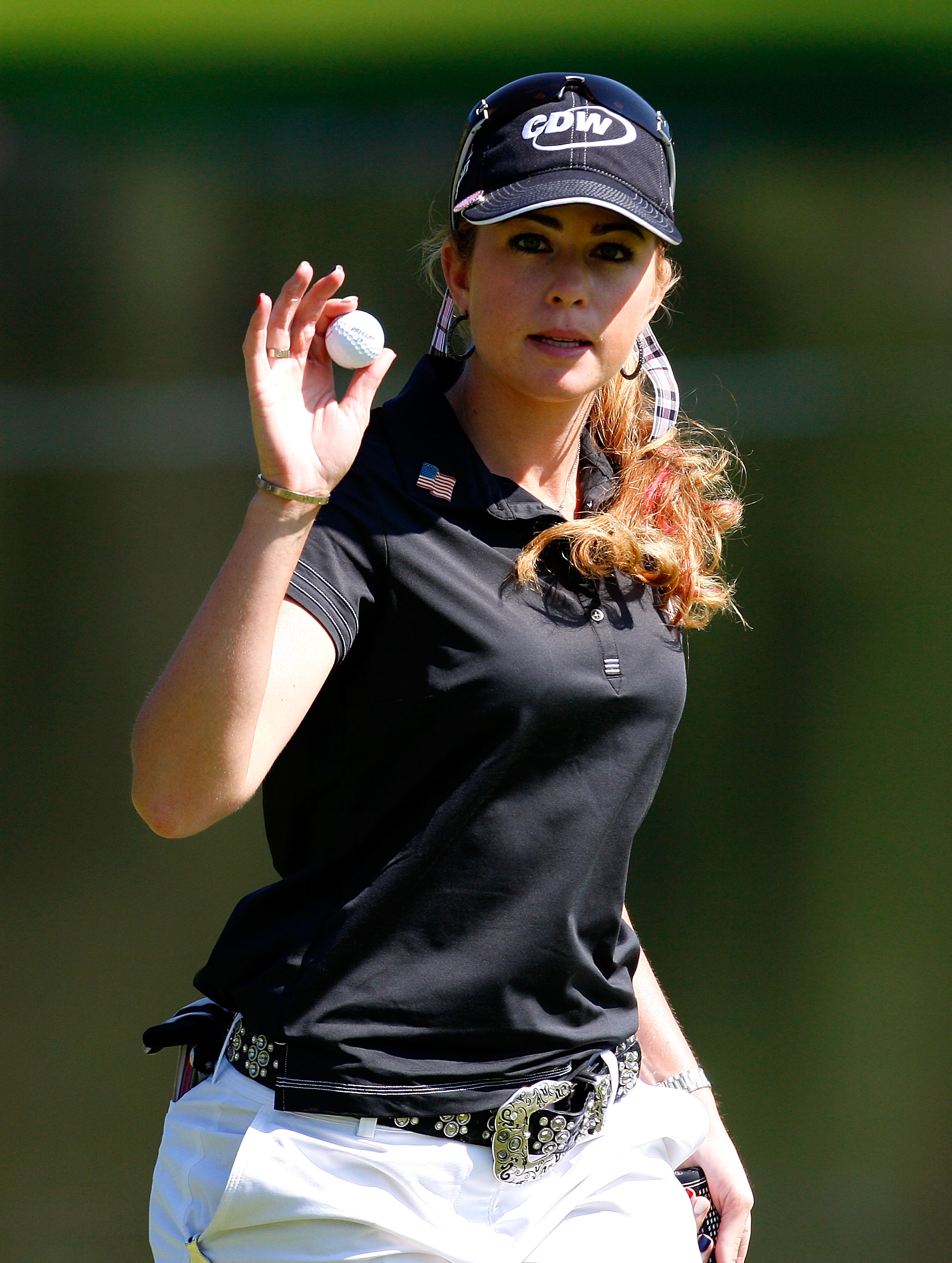 Paula Creamer reacts after saving par on the fourth hole during the first round of the Lorena Ochoa Invitational.