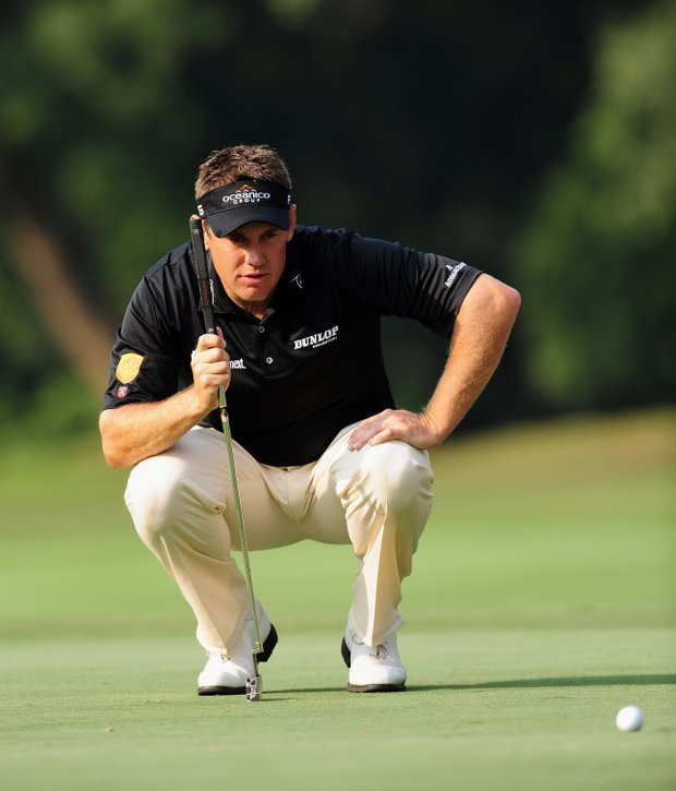 Lee Westwood lines up his putt on the 15th hole during the second round of the Hong Kong Open on Nov. 13.