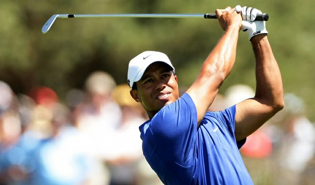 Tiger Woods plays an approach shot on the fourth hole during the second round of the Australian Masters.