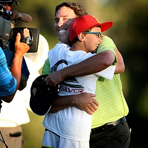 Stephen Ames gets a hug from his son Ryan Ames, 10, after winning on the second playoff hole. George McNeill made a bogey.