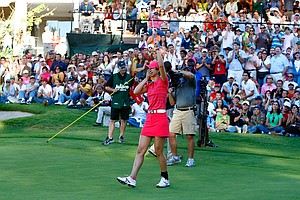 Michelle Wie celebrates after her winning birdie putt Nov. 15 at the Lorena Ochoa Invitational.