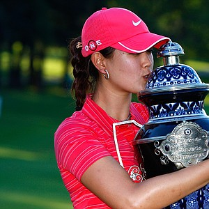 Michelle Wie with the trophy after winning her first LPGA title at the Lorena Ochoa Invitational.