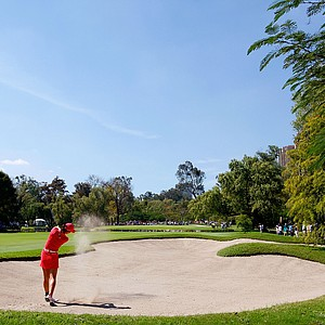 Michelle Wie hits out of the sand trap onto the fourth green during the final round of the Lorena Ochoa Invitational.