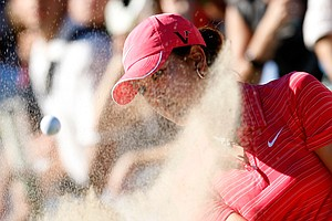 Michelle Wie blasts out of the sand trap onto the 18th green during the final round of the Lorena Ochoa Invitational.