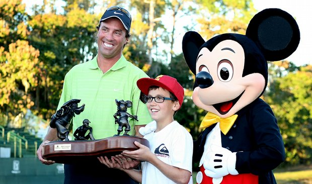 Stephen Ames holds the championship trophy with son, Ryan, 10, and Mickey Mouse after winning the Children's Miracle Network Classic on Nov. 15.