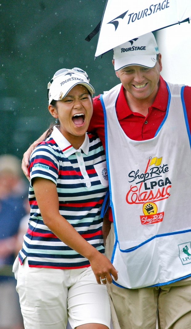 Ai Miyazato and her caddy, Mick Seabourn, share a laugh during the 2006 ShopRite championship.