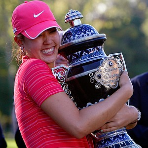 Michelle Wie hugging her first LPGA trophy.