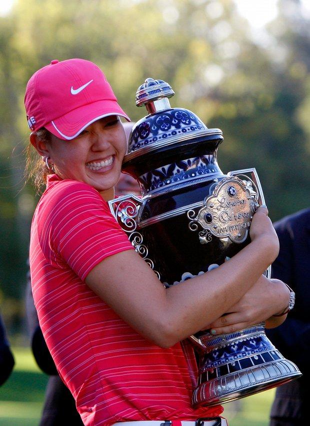 Michelle Wie hugging her first LPGA trophy.
