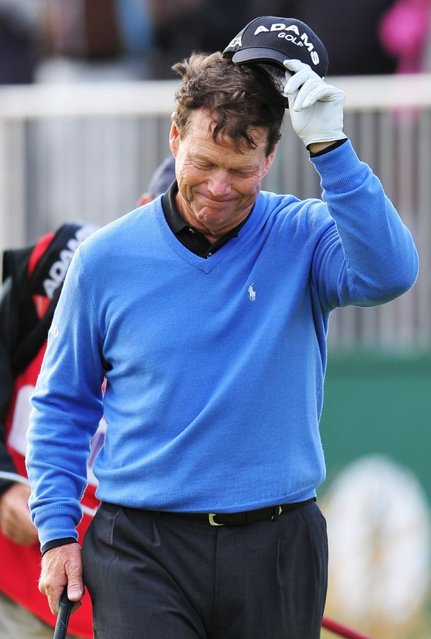 Tom Watson walks across the 18th green after being defeated in a playoff by Stewart Cink at the 2009 British Open.
