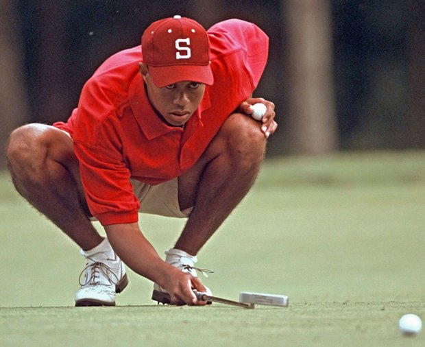 Woods was a two-time All-American at Stanford and posted 10 college victories.