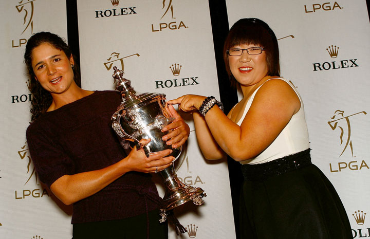 Jiyai Shin wrestles Lorena Ochoa for the Player of the Year trophy at the 2009 Rolex LPGA Awards Reception Nov. 20.