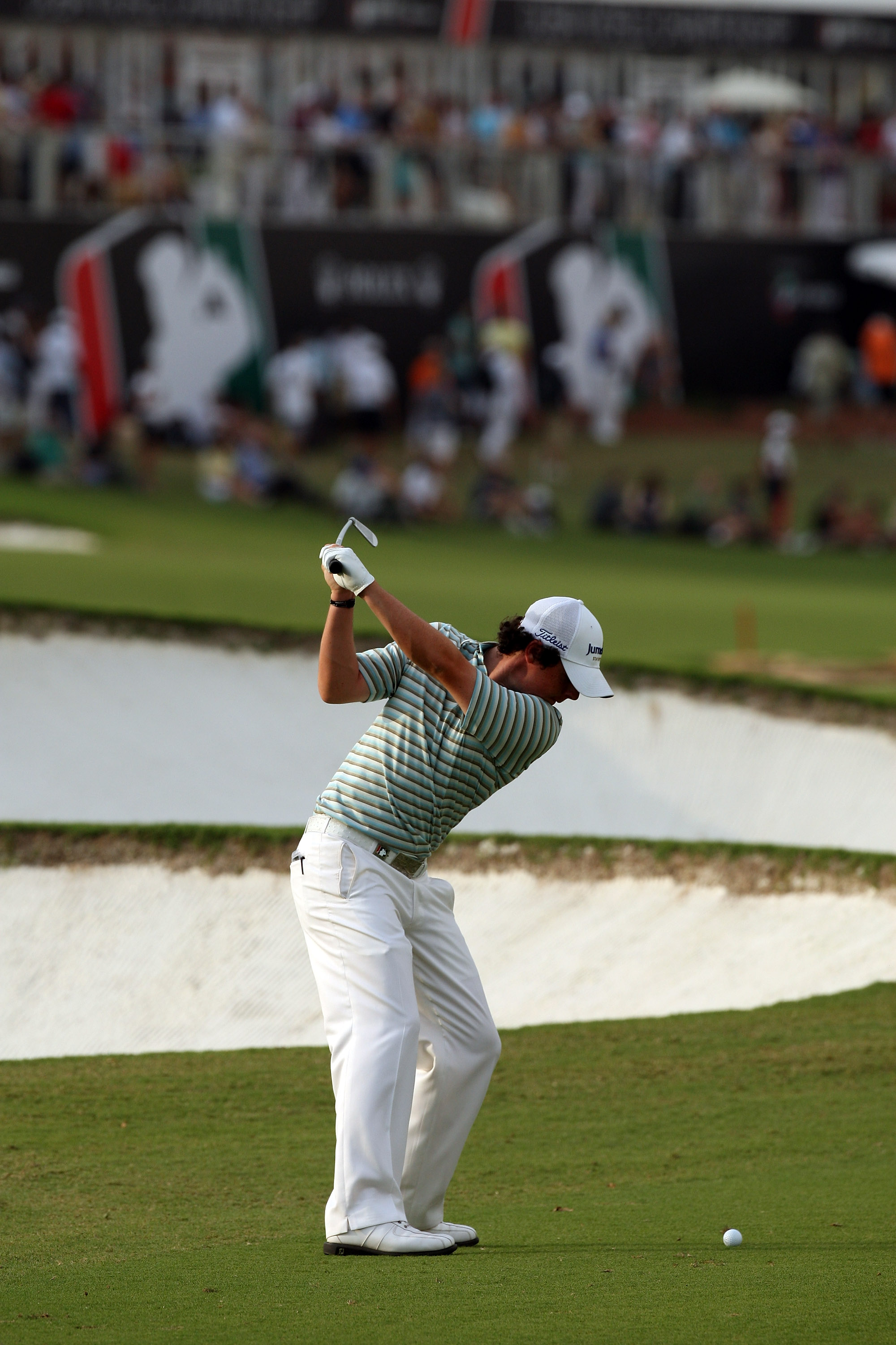 Rory McIlroy plays his second shot at the 18th hole during the final round of the Dubai World Championship.