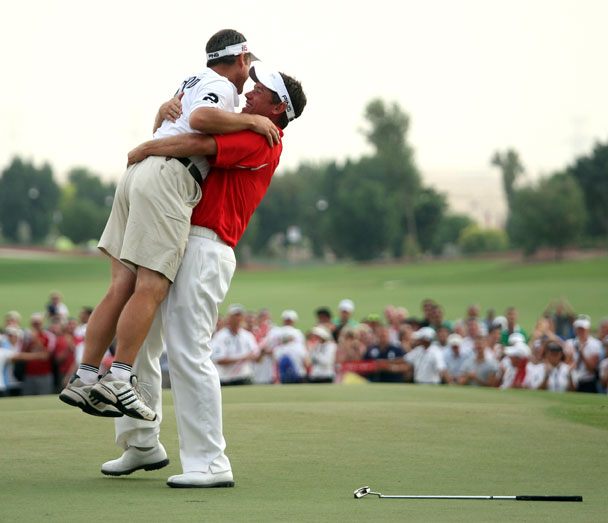 Lee Westwood lifts his caddie Billy Foster in celebration.