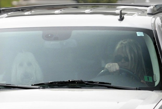 Elin Nordegren, wife of golfer Tiger Woods, leaves the Isleworth subdivision in Windermere, Fla., on Saturday, Nov. 28.