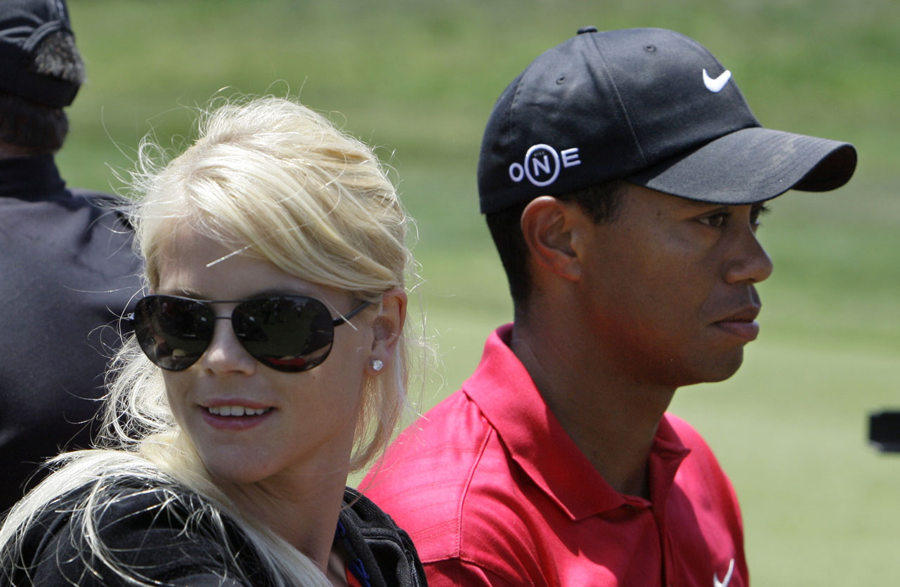 Tiger Woods' wife, Elin Nordegren, rides in a golf cart next to Woods at the 2008 U.S. Open.