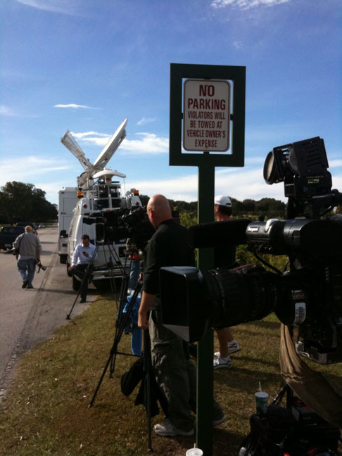 Media gather across the street from the main gate of Isleworth Nov. 28.