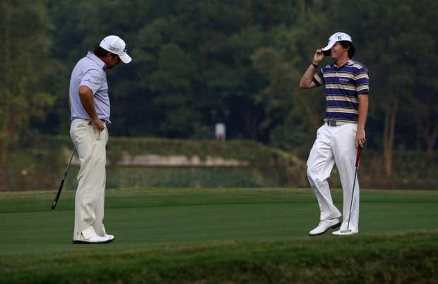 Graeme McDowell, left, and Rory McIlroy of Ireland react after losing by one shot.