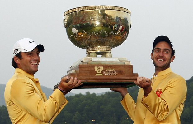 Edoardo Molinari, right, and Francesco Molinari of Italy celebrate after winning the 2009 Omega Mission Hills World Cup.