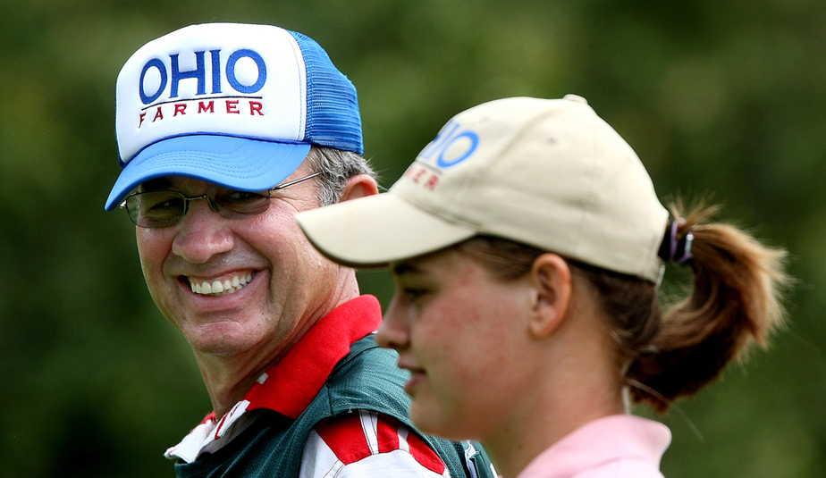 Tim White caddies for his daughter, Allie White, at the U.S. Women's Amateur.