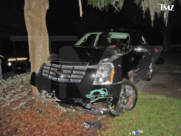 This photo taken Nov. 27, 2009 and provided by the celebrity Web site TMZ.com shows a Cadillac Escalade that Tiger Woods crashed into a tree outside his home in Windermere, Fla. (AP Photo/TMZ)