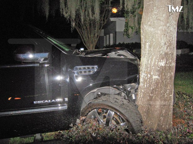 This photo taken Nov. 27, 2009 and provided by the celebrity Web site TMZ.com shows a Cadillac Escalade that Tiger Woods crashed into a tree outside his home in Windermere, Fla.