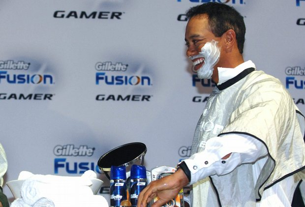 Tiger Woods participates in a promotion for the Gillette Fusion Power Gamer razor during the Gillette-EA Sports Champions of Gaming Finals in Orlando, Fla., Feb. 3, 2009.