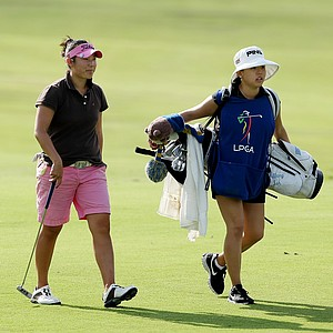 Tiffany Joh walks up No. 8 with her caddie, LPGA player Jane Park, during Wednesday's round.