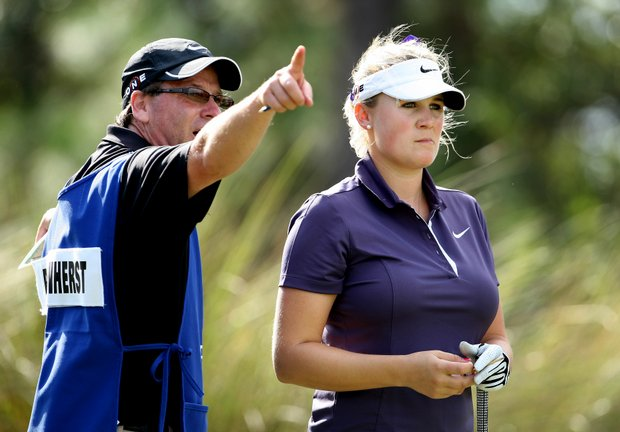 Amanda Blumenherst, right, talks with her caddie/uncle Bill Blumenherst at No. 9.