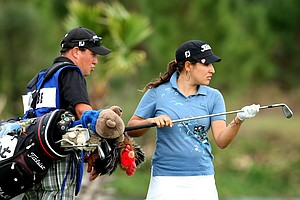 Mariajo Uribe with her caddie at No. 18.