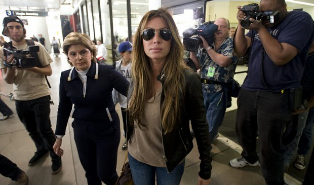 Rachel Uchitel arrives from New York at the Los Angeles International Airport on Nov. 29. Gloria Allred, left, met her at the airport.