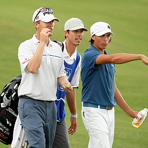 Rickie Fowler, right, talks with Chris Riley, left, at No. 10. Riley holed out from the fairway at No. 10.