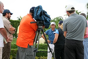 Rickie Fowler talks with the media after his round on Friday at PGA Qualifying School.