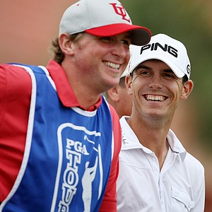 Billy Horschel has a laugh with his caddie at the 10th tee.