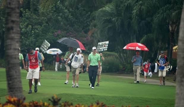 Players leave the course at the start of the nearly 4-hour weather delay during Saturday's play of PGA Qualifying School.