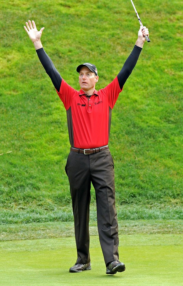 Jim Furyk celebrates a long par putt on the 17th hole at the Chevron World Challenge.
