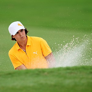 Rickie Fowler hits out of a bunker at No. 11.