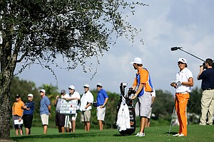 Rickie Fowler at No. 9, surrounded by spectators and media,  during Monday's final round.