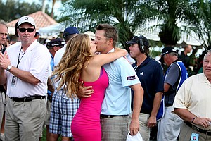 Matt Jones gets a hug from his fiance, Melissa Weber, after he secured his PGA Tour card.