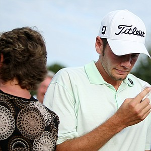 Troy Merritt wipes away tears after securing his PGA Tour card.